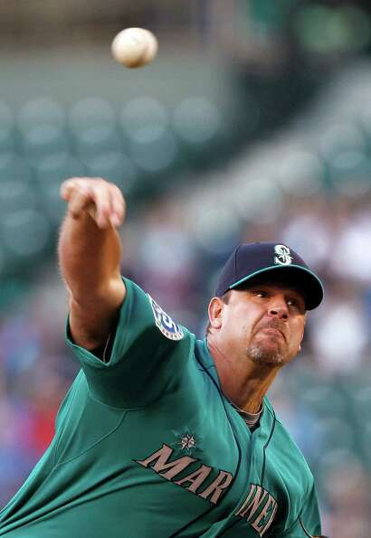 Seattle Mariners starting pitcher Kevin Millwood throws to a Los Angeles Dodgers batter in the secon