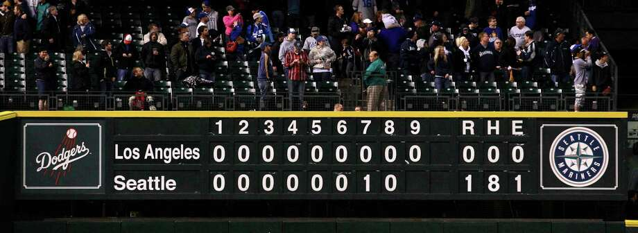 The scoreboard is seen after the Seattle Mariners beat the Los Angeles Dodgers in a baseball game Friday, June 8, 2012, in Seattle. The Mariners won 1-0 in a six-pitcher combined no-hitter. Photo: AP