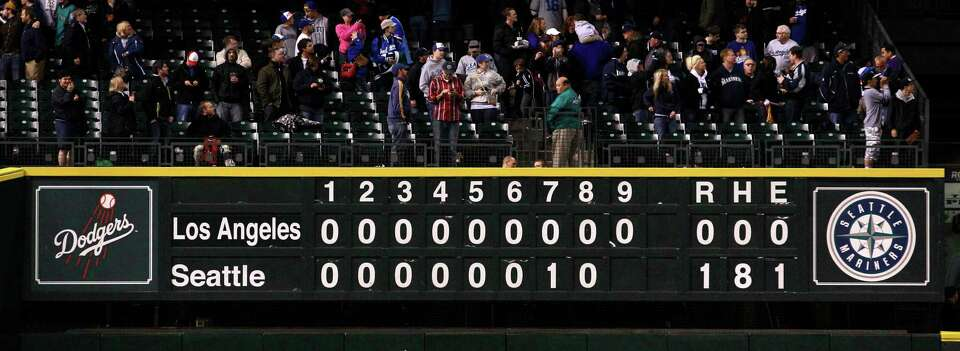 The scoreboard is seen after the Seattle Mariners beat the Los Angeles Dodgers in a baseball game Fr