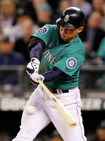 Seattle Mariners' Kyle Seager singles in a run against the Los Angeles Dodgers in the seventh inning of a baseball game Friday, June 8, 2012, in Seattle. The Mariners won 1-0 on a six-pitcher combined no-hitter. Photo: AP
