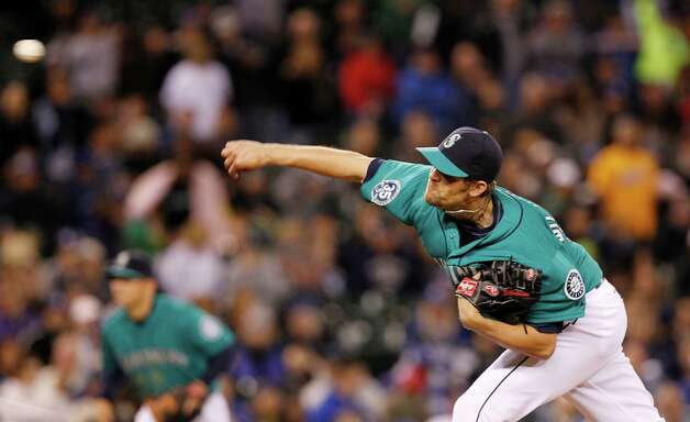 Seattle Mariners closer Tom Wilhelmsen throws against the Los Angeles Dodgers  in the ninth inning of a baseball game Friday, June 8, 2012, in Seattle. The Mariners won 1-0 in a six-pitcher combined no-hitter. Photo: AP