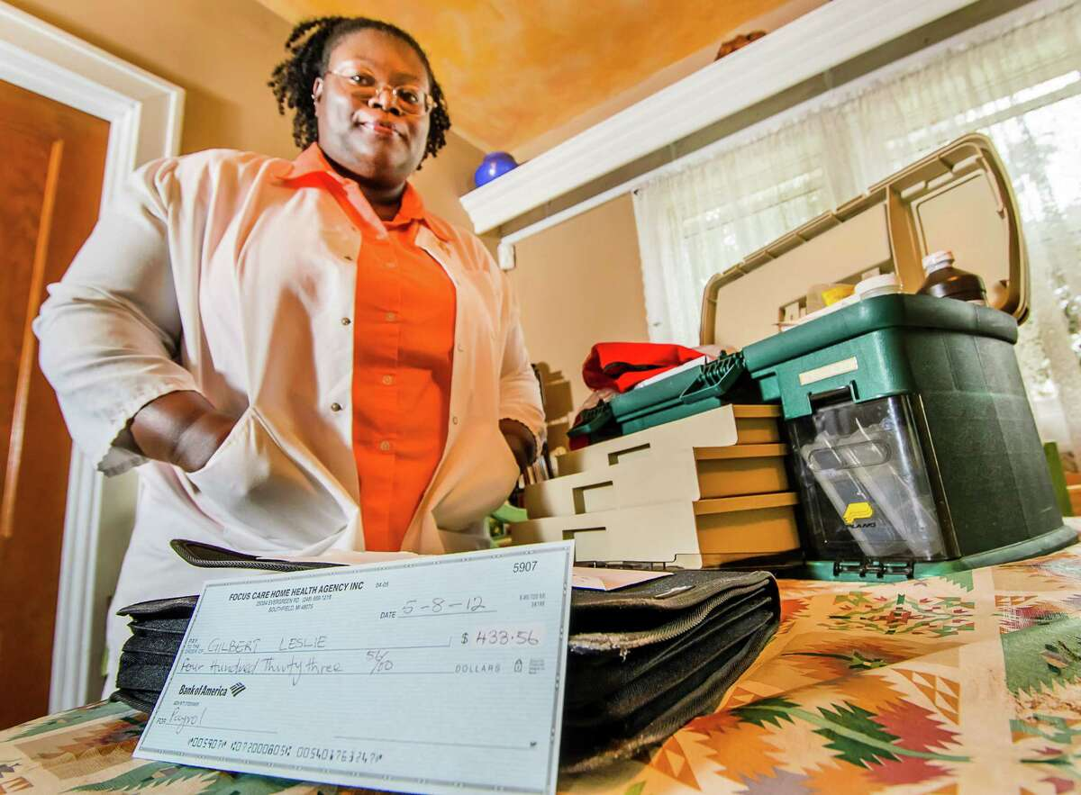 Leslie Gilbert, a former employee of Focus Care Home Health in Grand Rapids, Mich., displays the check she was sent in compensation for back wages. It was for the wrong amount, and unsigned. She's since filed a complaint with the state.