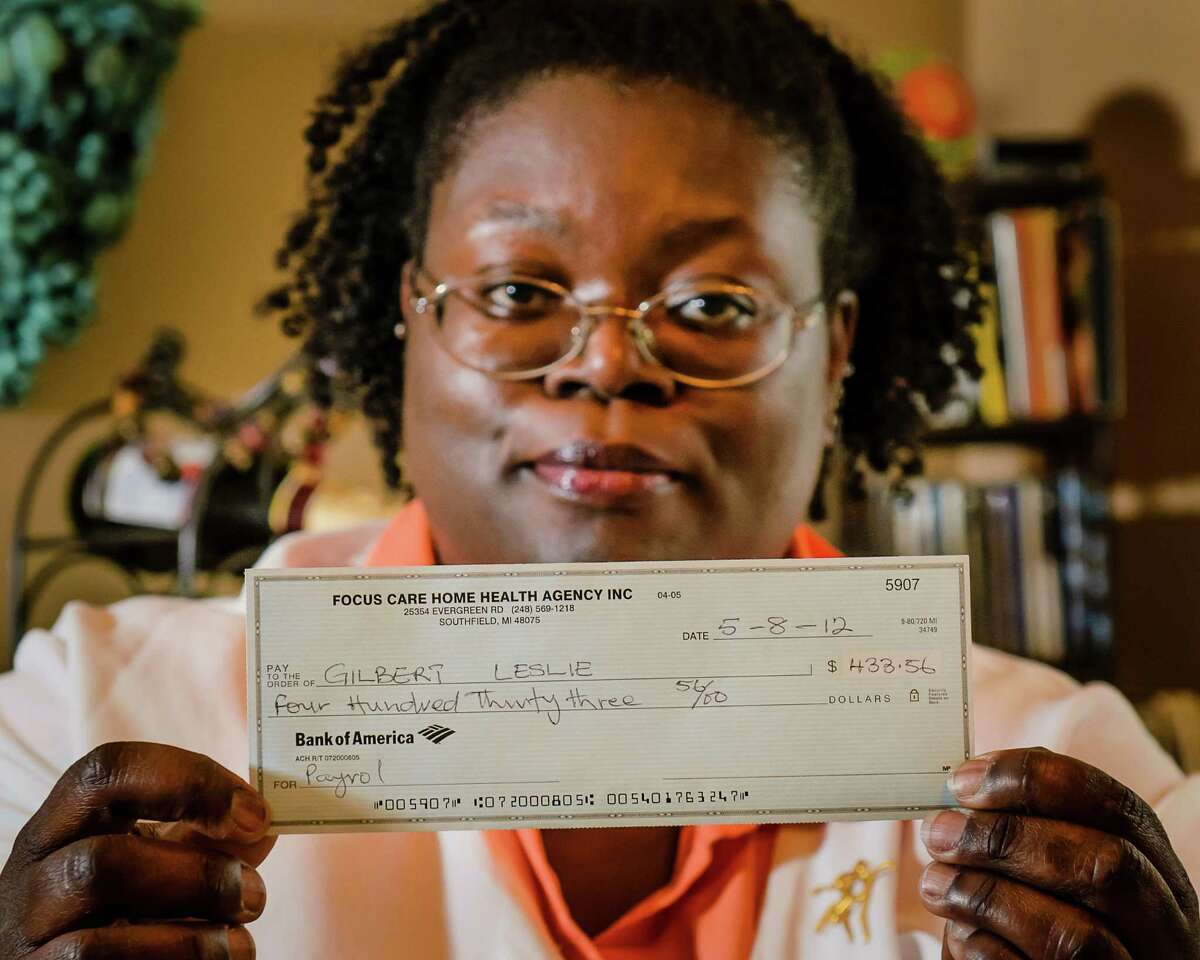 Leslie Gilbert, a former employee of Focus Care Home Health, displays the check she received from Focus Care Home Health in compensation for back wages, Wednesday, May 30, 2012 in Grand Rapids, Michigan. After filing a complaint with the Michigan Wage and Hour Division the Focus Care Home Health forwarded Gilbert the check. Unfortunately, it's for the incorrect amount. And not signed. (Kevin W. Fowler/MCT)