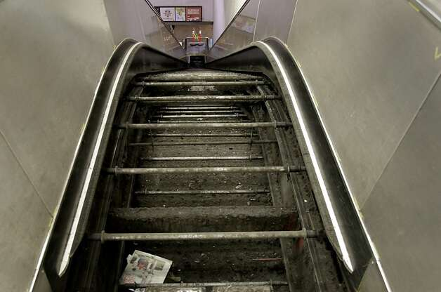 An escalator at the Powell Street station in disrepair. BART had a record 28 escalators out of service recently. The agency blames aging components, weather, vandalism and homelessness.  There were two escalators out of service at the Powell Street Station Sunday June 3, 2012, one leading from Powell Street to the station, and one leading down to the trains. Photo: Brant Ward, The Chronicle