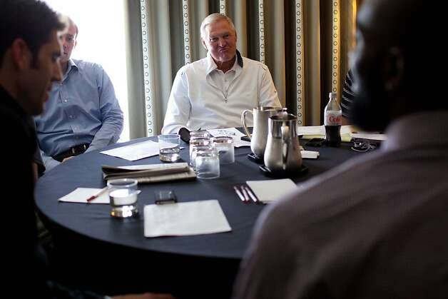 Golden State Warriors executive board member Jerry West (center) listens as a prospect answers questions during a roundtable interview with Warriors executives during the NBA draft combine in Chicago on Thursday, June 7, 2012. Photo: Jeff Cagle, Special To The Chronicle