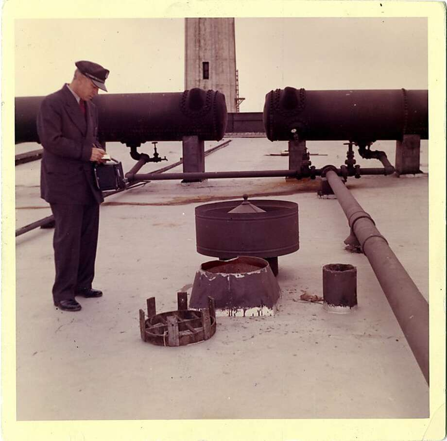This 1962 photo from the U.S. Penitentiary Alcatraz shows correctional officer Orrin T. Maybee looking over the vent, grill and cover used as an escape exit. Photo: Handout Photo, U. S. Penitentiary Alcatraz