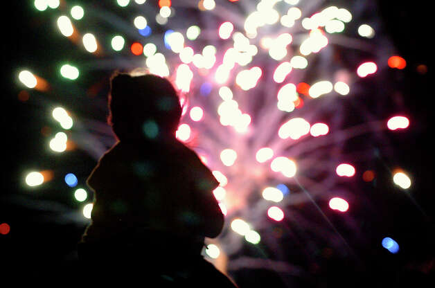 A little girl on her dad's shoulders watches the Fourth of July fireworks display at Wolff Stadium Monday night.  The Missions baseball team had played earlier and the fireworks were proceeded by a concert by Robert Earl Keene.  Tom Reel/Staff   July 4, 2005.