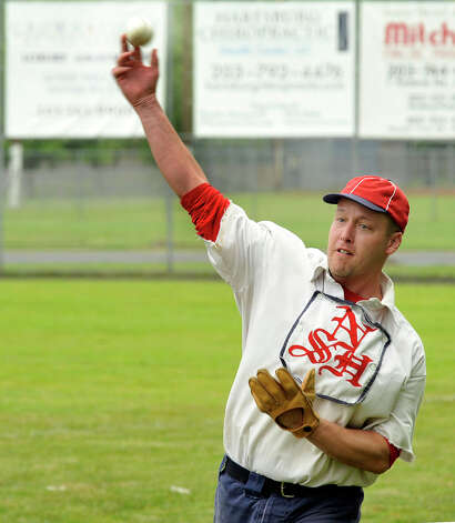 """Hurler"" Jay ""Mr."" Edwards pitches a ball as the Newtown Sandy Hooks play Westfield Wheelmen in a vintage baseball game, played in costume and rules from 1886, in Danbury Saturday, June 9, 2012. Photo: Michael Duffy / The News-Times"