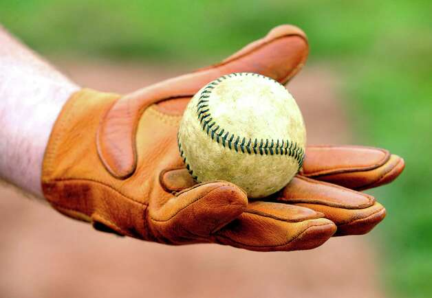 This shows a ball and glove used in game as the Newtown Sandy Hooks play Westfield Wheelmen in a vintage baseball game, played in costume and rules from 1886, in Danbury Saturday, June 9, 2012. Photo: Michael Duffy / The News-Times