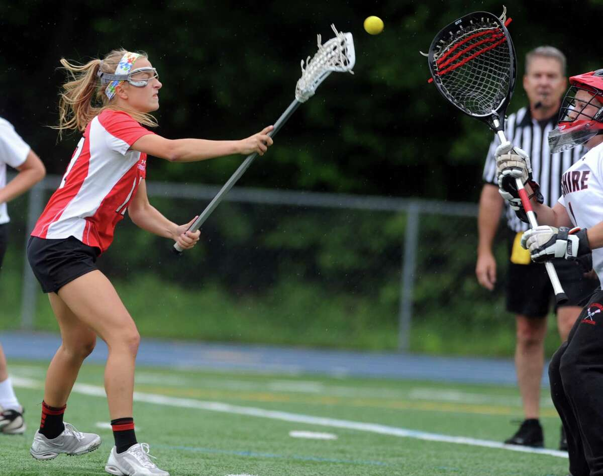 Greenwich's Sophie Waine scores a goal during the Girls Lacrosse State Tournament Class L final against Cheshire Saturday, June 9, 2012 at Bunnell High School in Stratford, Conn.