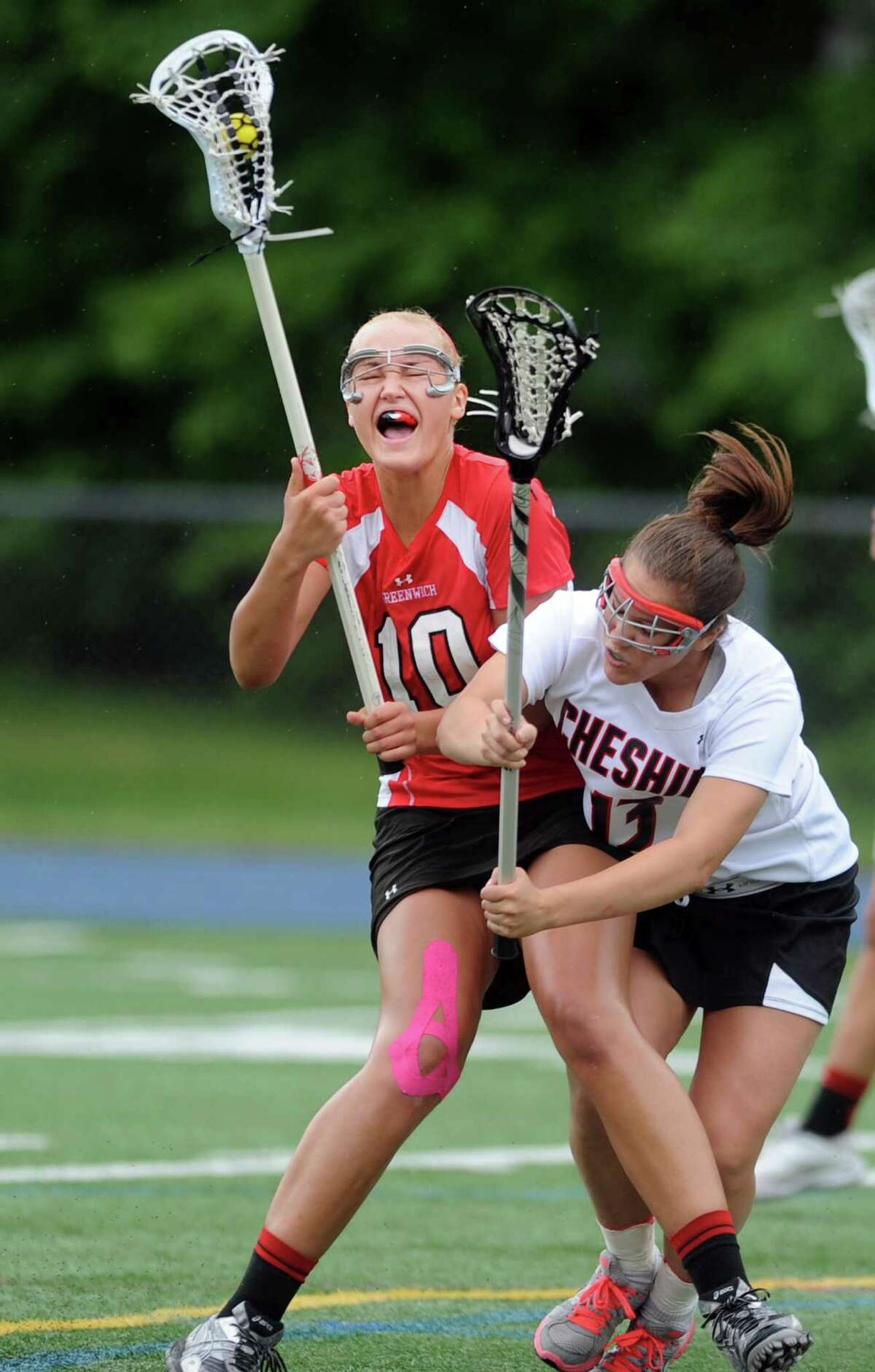 Greenwich's Emily Johnson controls the ball as Cheshire's Natalie Barnett slams into her during the Girls Lacrosse State Tournament Class L final Saturday, June 9, 2012 at Bunnell High School in Stratford, Conn.