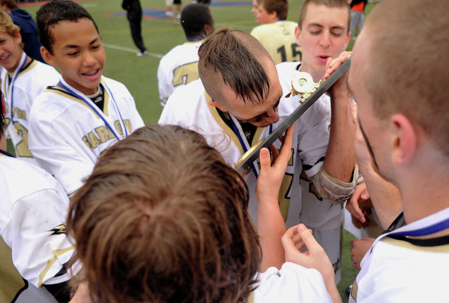 Joel Barlow's Nick Taylor kisses his team's Class S state tournament trophy after beating Somers, 15-2, at Brien McMahon High School in Norwalk, Conn., on Saturday, June 9, 2012. Photo: Jason Rearick / The News-Times