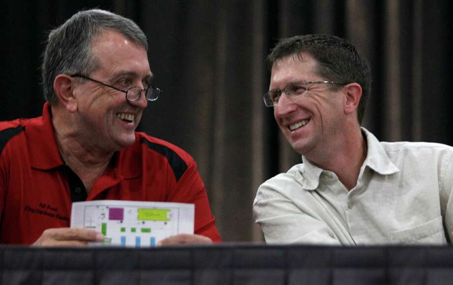 Bill Read, left, former director at the National Hurricane Center, and Rick Knabb, right, the new director of the National Hurricane Center, visit together during the Houston/Galveston National Weather Service 2012 Hurricane Workshop. Photo: Melissa Phillip, Houston Chronicle / © 2012 Houston Chronicle