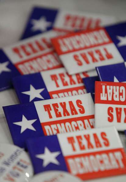 Political buttons shown at a booth during the Texas Democratic Convention at the George R. Brown Con