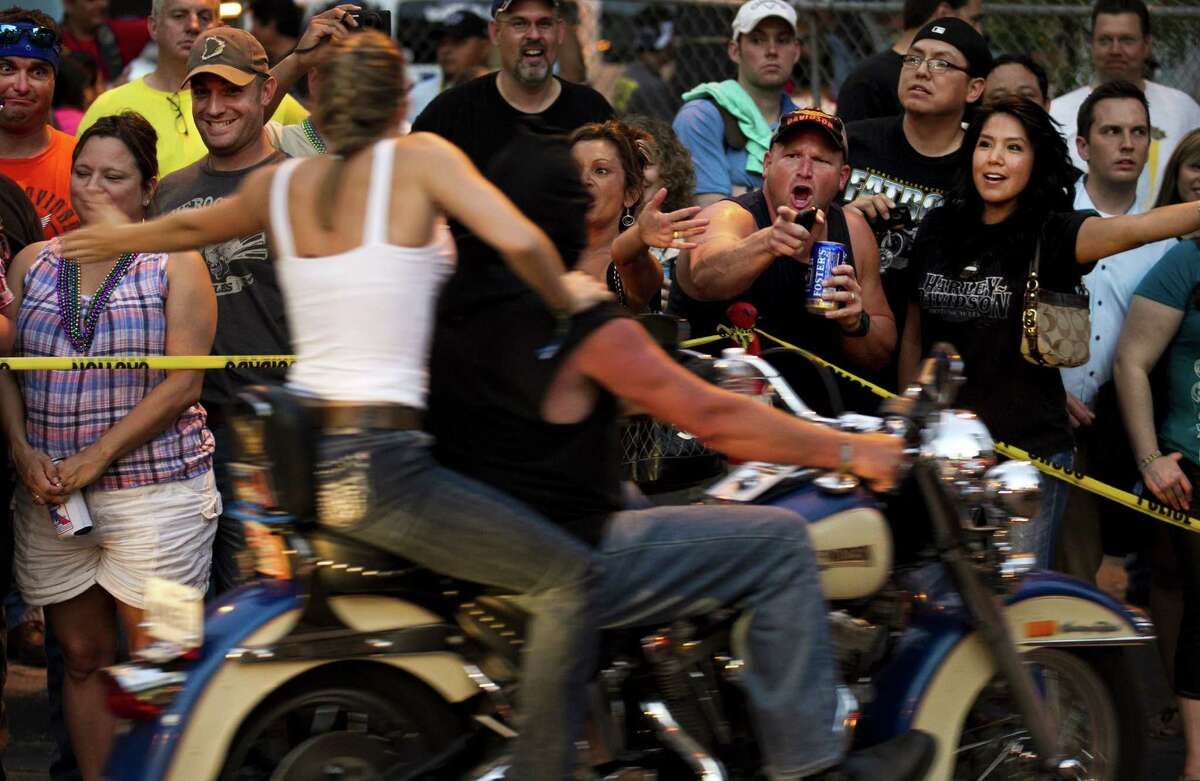 Spectators watch as thousands of bikers roar past at Republic of Texas Biker Rally parade in downtown Austin, Texas, on Friday June 8, 2012. About 40,000 bikers have descended on Austin for the 18th annual R.O.T. Rally, the biggest motorcycle rally in Texas and the fifth-largest in the U.S.