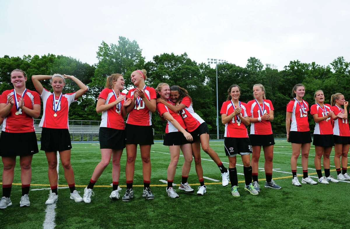Greenwich celebrates their win over Cheshire in the Girls Lacrosse State Tournament Class L final Saturday, June 9, 2012 at Bunnell High School in Stratford, Conn.