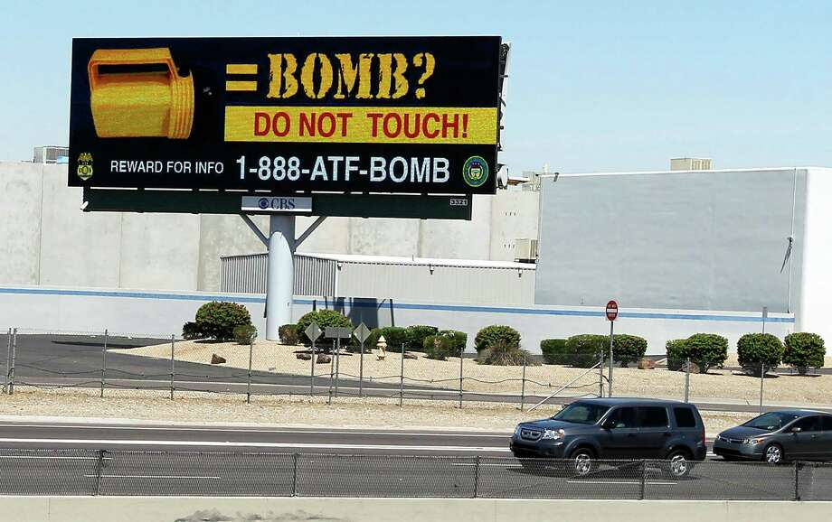 Public service billboards are being put up in Phoenix warning citizens about picking up discarded flashlights.  In three separate incidents, bombs have exploded and injured five people. Photo: Ross D. Franklin / AP