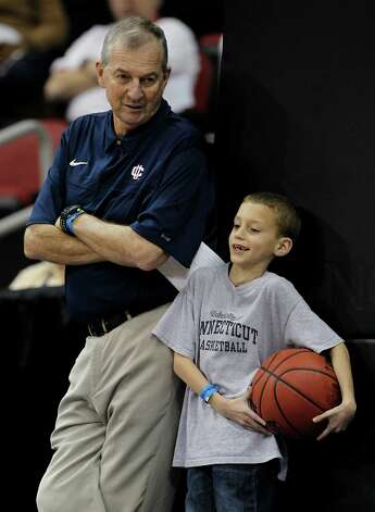 Connecticut head coach Jim Calhoun talks with his grandson Sam during basketball practice in Louisville, Ky., Wednesday, March 14, 2012. Calhoun shows no signs he plans on not returning as UConn's head coach. Photo: John Bazemore, Associated Press / AP