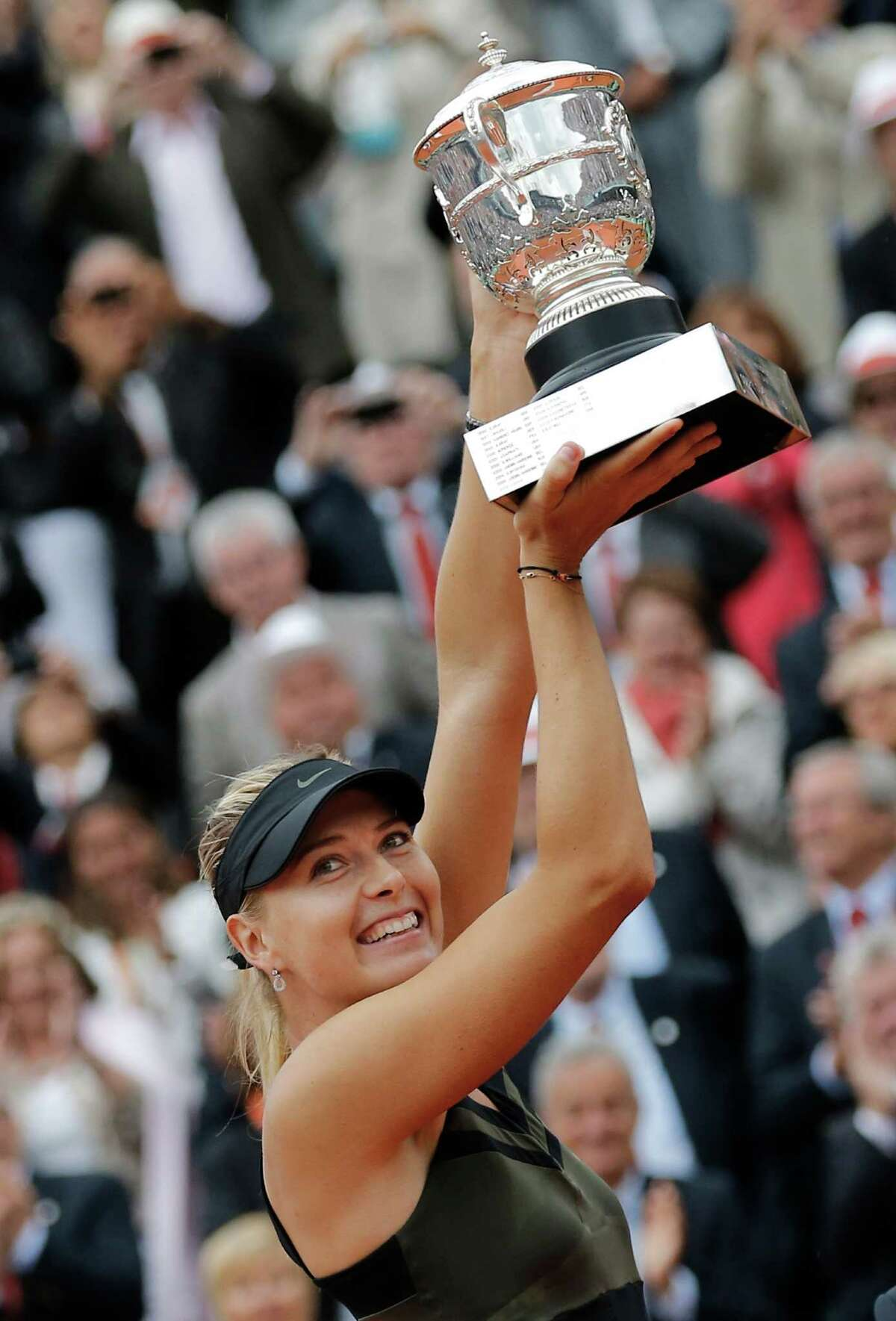 Maria Sharapova defeated Sara Errani 6-3, 6-2 for her first French Open title.