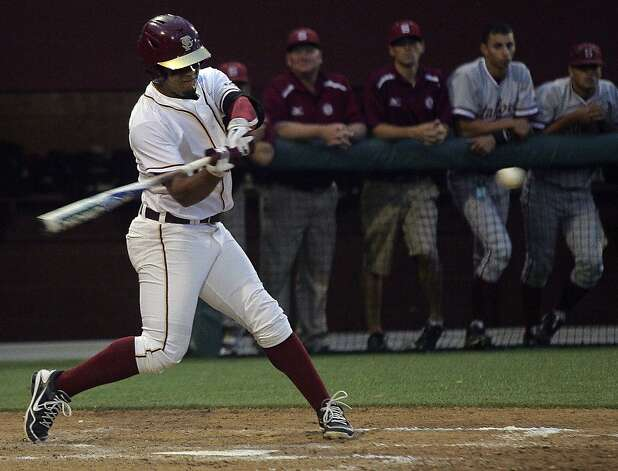 Florida State's Devon Travis (8) gets an RBI-single in the fourth inning of an NCAA college baseball tournament super regional game against Stanford, Friday, June 8, 2012, in Tallahassee, Fla. (AP Photo/Phil Sears) Photo: Phil Sears, Associated Press
