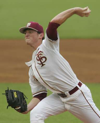 Florida State pitcher Brandon Leibrandt throws in the first inning of an NCAA college baseball tournament super regional game against Stanford, Friday, June 8, 2012, in Tallahassee, Fla. (AP Photo/Phil Sears) Photo: Phil Sears, Associated Press