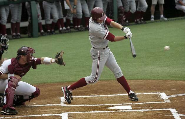 Stanford's Stephen Piscotty, right, hits an RBI-single against Florida State in the first inning of an NCAA college baseball tournament super regional game on Friday, June 8, 2012, in Tallahassee, Fla. (AP Photo/Phil Sears) Photo: Phil Sears, Associated Press