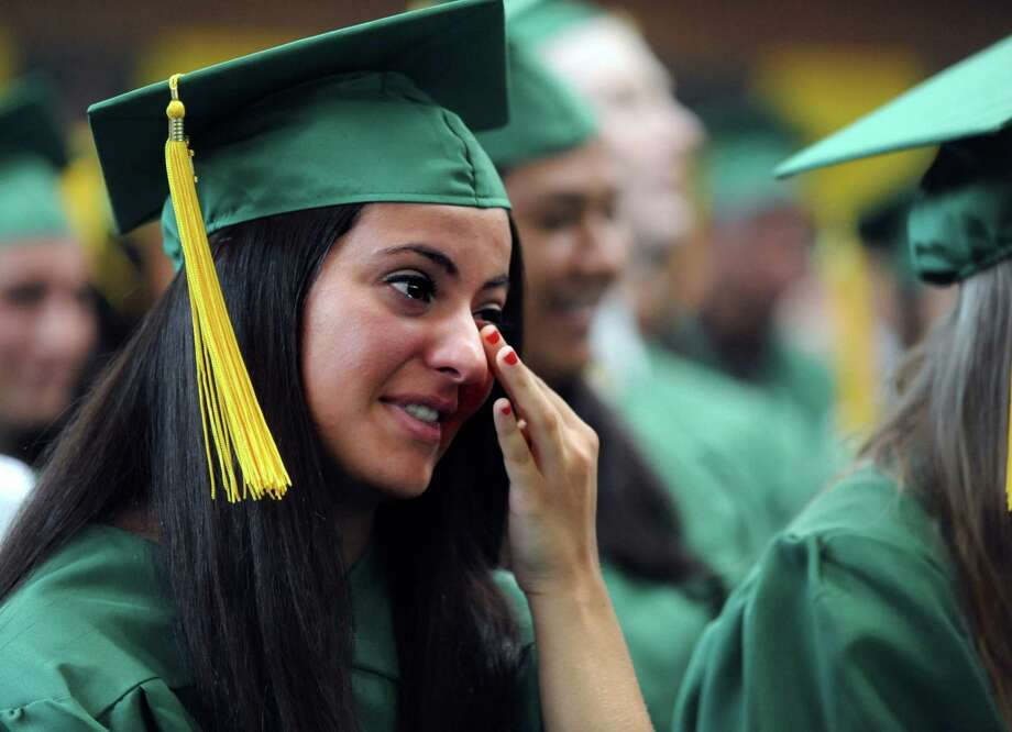 Jessica Lofaro wipes away a tear during Saturday's graduation ceremony at Trinity Catholic High School in Stamford on June 9, 2012. Photo: Lindsay Niegelberg / Stamford Advocate