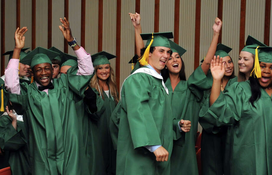 Students cheer before proceeding to the gymnasium before Saturday's graduation ceremony at Trinity Catholic High School in Stamford on June 9, 2012. Photo: Lindsay Niegelberg / Stamford Advocate