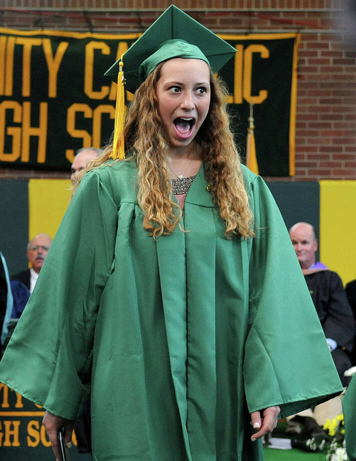 Jacqueline Kanzler reacts after getting her diploma during Saturday's graduation ceremony at Trinity Catholic High School in Stamford on June 9, 2012. Photo: Lindsay Niegelberg / Stamford Advocate