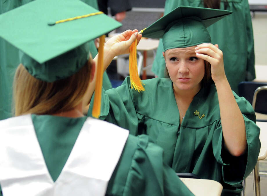 Victoria Gargiulo fixes her cap before Saturday's graduation ceremony at Trinity Catholic High School in Stamford on June 9, 2012. Photo: Lindsay Niegelberg / Stamford Advocate
