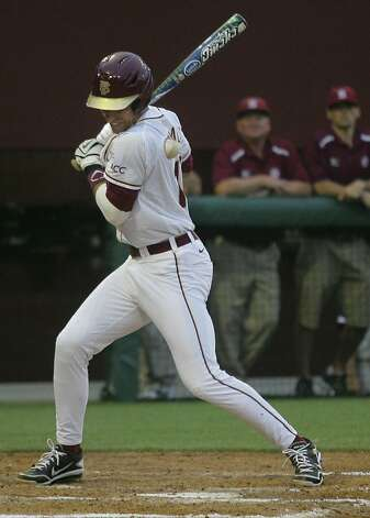 Florida State's Justin Gonzalez is hit by a pitch from Stanford's Mark Appel in the fourth inning of an NCAA college baseball tournament super regional game on Friday, June 8, 2012, in Tallahassee, Fla. (AP Photo/Phil Sears) Photo: Phil Sears, Associated Press