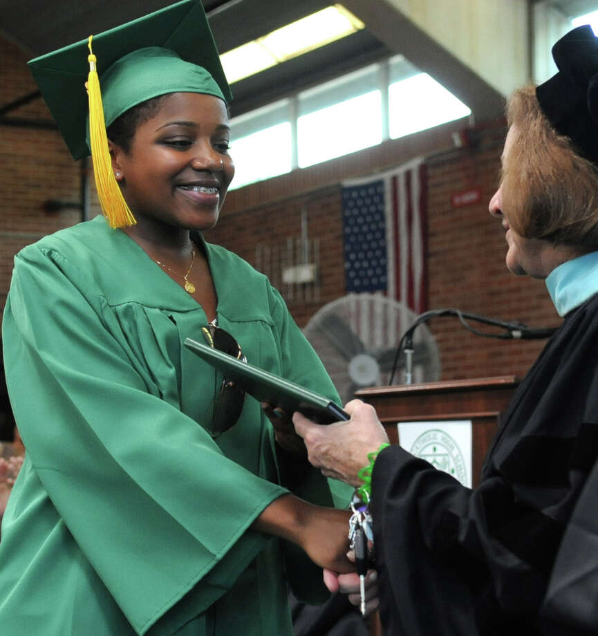 Maureen Boursiquot gets her diploma during Saturday's graduation ceremony at Trinity Catholic High School in Stamford on June 9, 2012. Photo: Lindsay Niegelberg / Stamford Advocate