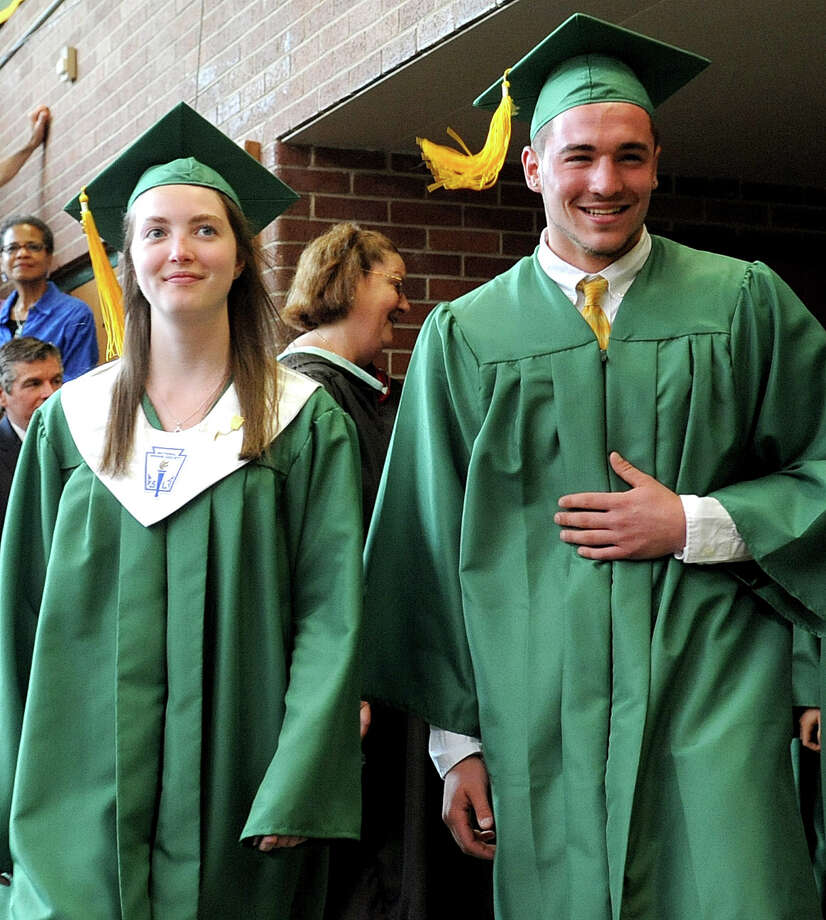 Students walk in the processional as they enter the gymnasium for Saturday's graduation ceremony at Trinity Catholic High School in Stamford on June 9, 2012. Photo: Lindsay Niegelberg / Stamford Advocate