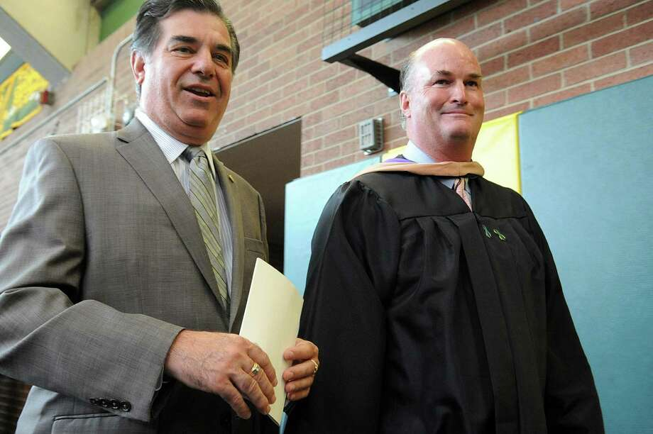Stamford Mayor Michael Pavia, left, and Trinity Catholic High School President Joseph Quinn enter the gymnasium before Saturday's graduation ceremony at Trinity Catholic High School in Stamford on June 9, 2012. Photo: Lindsay Niegelberg / Stamford Advocate