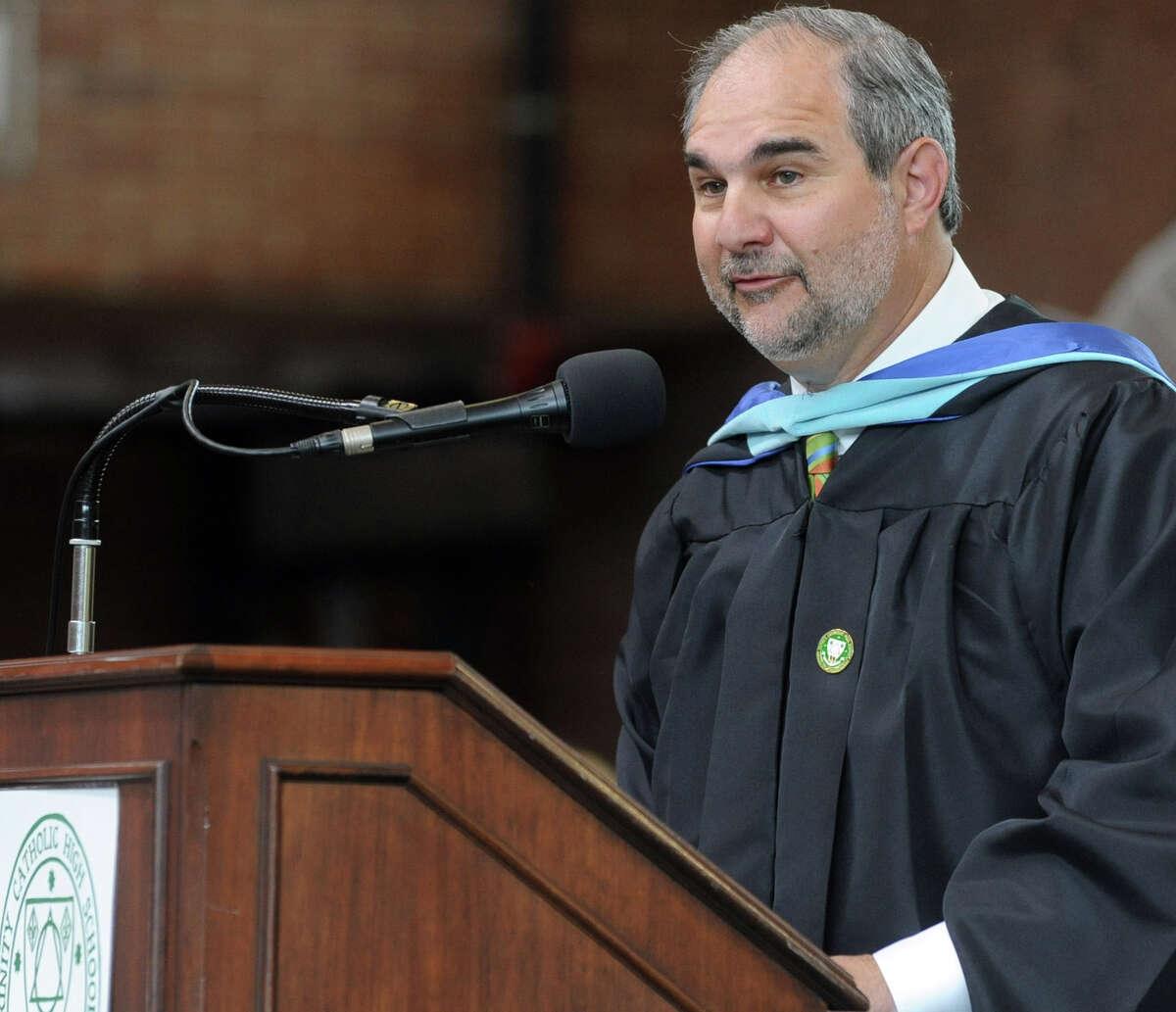 Principal Tony Pavia speaks during Saturday's graduation ceremony at Trinity Catholic High School in Stamford on June 9, 2012.