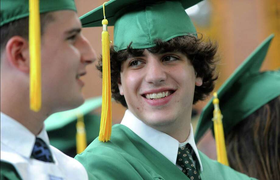 Robert Miliaresis smiles during Saturday's graduation ceremony at Trinity Catholic High School in Stamford on June 9, 2012. Photo: Lindsay Niegelberg / Stamford Advocate