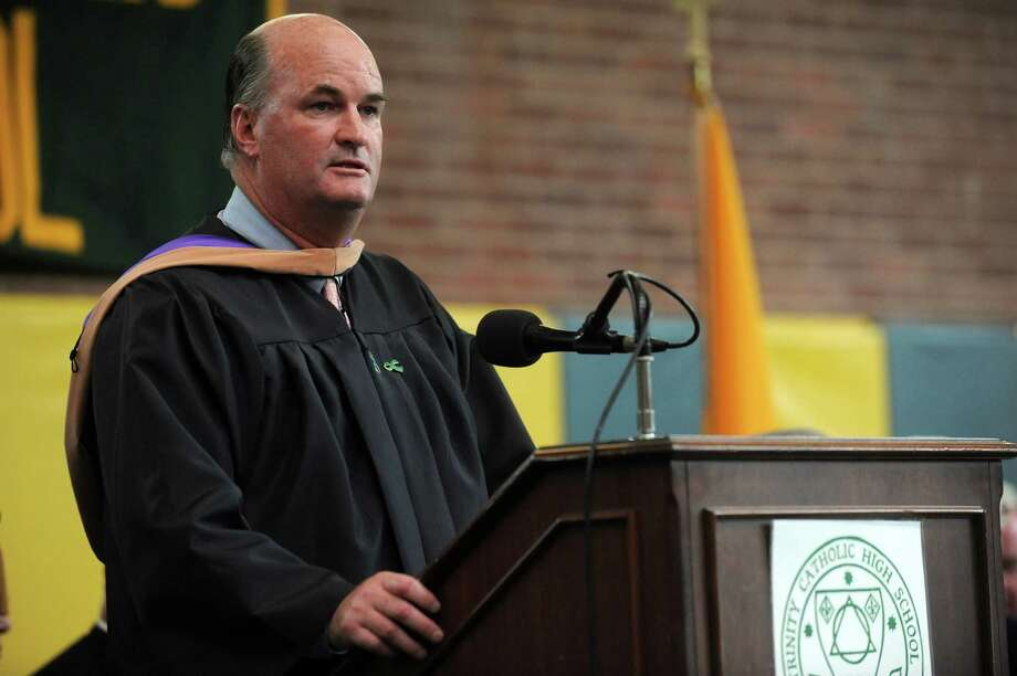 President Joseph Quinn speaks during Saturday's graduation ceremony at Trinity Catholic High School in Stamford on June 9, 2012. Photo: Lindsay Niegelberg / Stamford Advocate