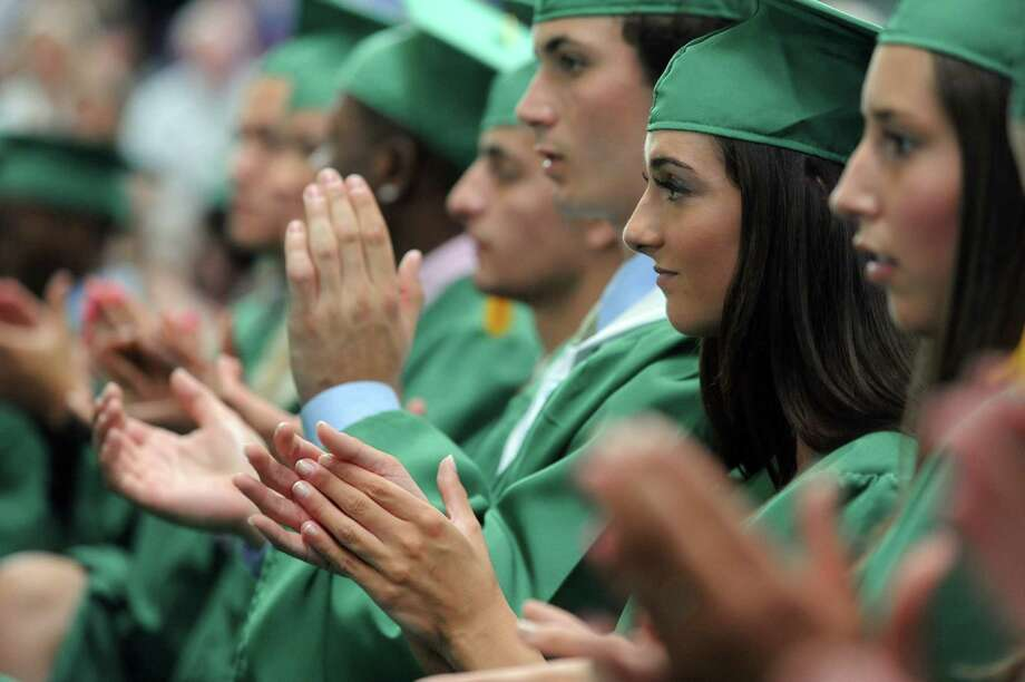 Students clap during Saturday's graduation ceremony at Trinity Catholic High School in Stamford on June 9, 2012. Photo: Lindsay Niegelberg / Stamford Advocate