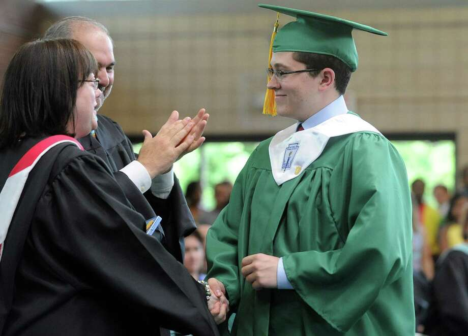 Sean Nulty gets the Social Studies award during Saturday's graduation ceremony at Trinity Catholic High School in Stamford on June 9, 2012. Photo: Lindsay Niegelberg / Stamford Advocate