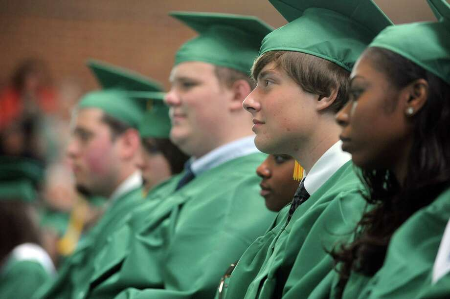Students listen to class valedictorian Kara Wintergrass speak during Saturday's graduation ceremony at Trinity Catholic High School in Stamford on June 9, 2012. Photo: Lindsay Niegelberg / Stamford Advocate