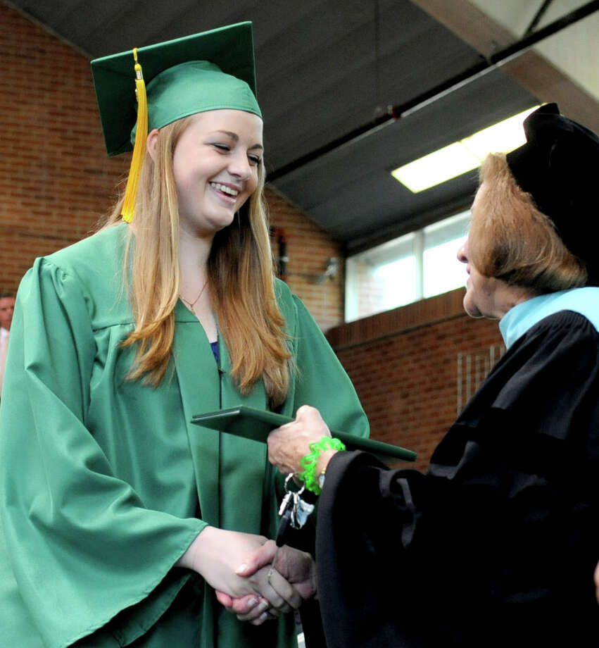 Lauren Connolly gets her diploma during Saturday's graduation ceremony at Trinity Catholic High School in Stamford on June 9, 2012. Photo: Lindsay Niegelberg / Stamford Advocate
