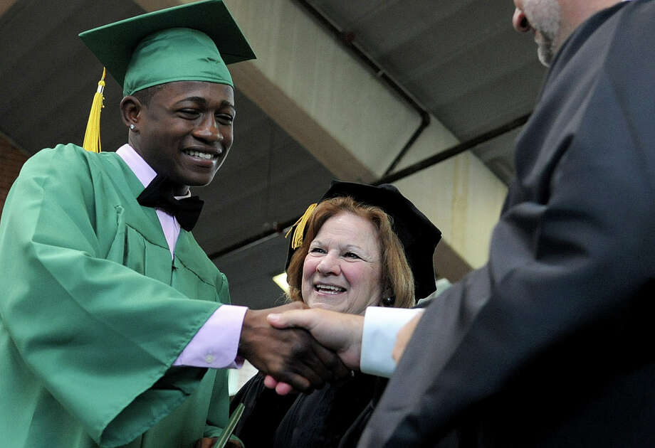 Michael Davis gets his diploma during Saturday's graduation ceremony at Trinity Catholic High School in Stamford on June 9, 2012. Photo: Lindsay Niegelberg / Stamford Advocate