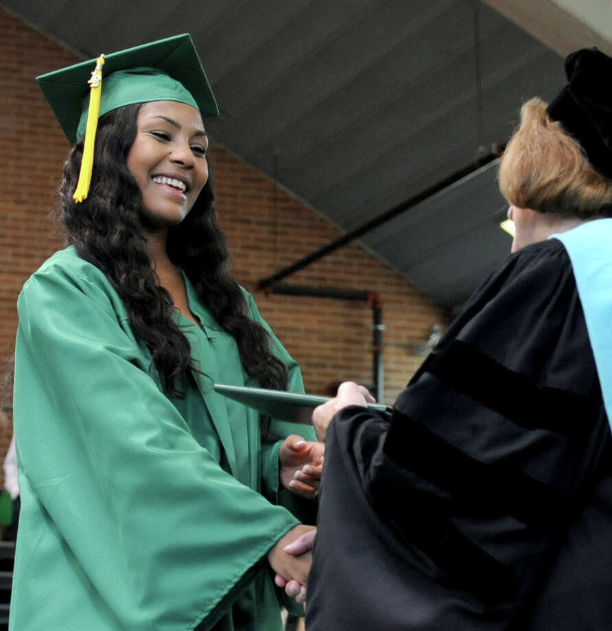Maya Ferguson gets her diploma during Saturday's graduation ceremony at Trinity Catholic High School in Stamford on June 9, 2012. Photo: Lindsay Niegelberg / Stamford Advocate