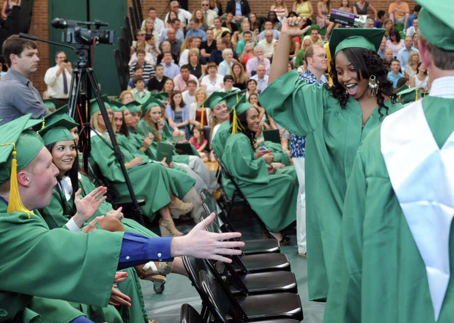 Immely Royal cheers after getting her diploma during Saturday's graduation ceremony at Trinity Catholic High School in Stamford on June 9, 2012. Photo: Lindsay Niegelberg / Stamford Advocate