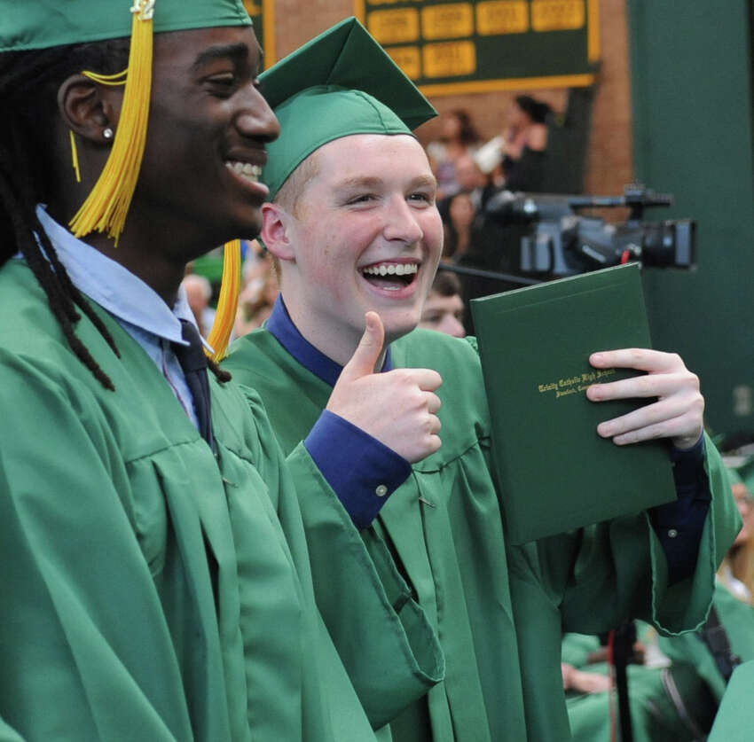 A student poses for a photo during Saturday's graduation ceremony at Trinity Catholic High School in Stamford on June 9, 2012.