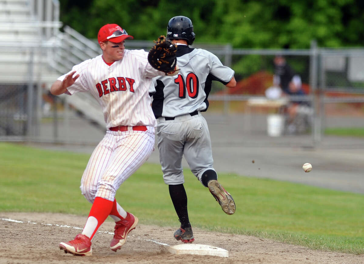 Derby's Zach Volo misses the throw to him allowing Cromwell's #10 Alexander Ramirez to advance to second, during Class S boys baseball state tournament action Middletown, Conn. on Saturday June 9, 2012.