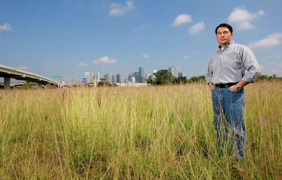 James Dinkins, president of the Downtown Super Neighborhood Council, stands in an empty lot in downtown Houston Saturday, June 9, 2012. There were plans for development that would have used federal housing subsidies to build modern-style lofts in the lot, but, it was scuttled by the developer after a competitor for the same subsidy sent letters to residents warning them that low-income tenants might be coming to their neighborhood. Photo: Cody Duty, Houston Chronicle / © 2011 Houston Chronicle