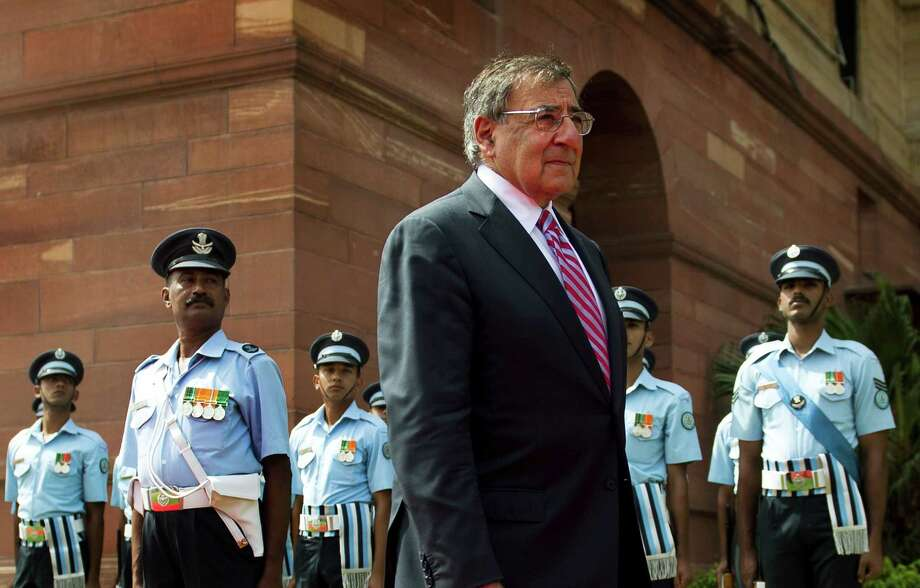 FILE - In this Wednesday, June 6, 2012 file photo, U.S. Defense Secretary Leon Panetta, center, inspects Indian troops during a welcoming ceremony at the Ministry of Defense in New Delhi, India. The U.S. and Pakistan are starting to look more like enemies than friends, threatening the U.S. fight against Taliban and al-Qaida militants based in the country and efforts to stabilize neighboring Afghanistan before American troops withdraw. Secretary of Defense Leon Panetta raised the temperature this past week by joking during a trip to Pakistan's archenemy India about how the U.S. didn't tell Islamabad about the covert Navy SEAL raid that killed Osama bin Laden last year in a Pakistani garrison town. Pakistani officials were infuriated they were kept in the dark, and the country's army was humiliated that it wasn't able to stop the American operation.(AP Photo/Jim Watson, Pool, File) Photo: Jim Watson / AFP Pool