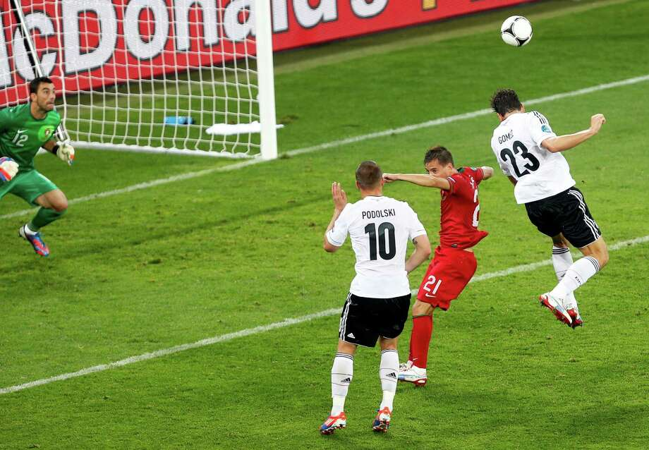 Germany's Mario Gomez connects on a header in the 72nd minute past Portugal keeper Rui Patricio for the winning goal in a Group B opening-round match of  Euro 2012 in Lviv, Ukraine. Sami Khedira provided the cross. Photo: Darko Vojinovic / AP