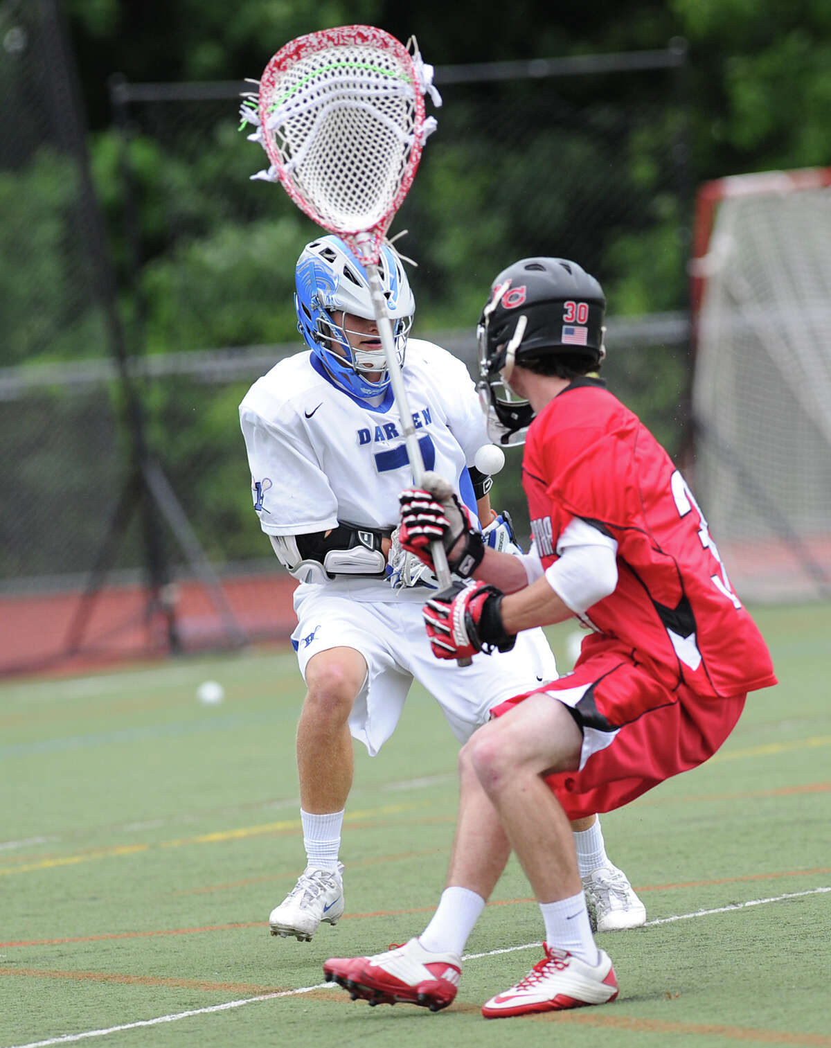 Goalie Thomas Carey, right, of New Canaan challenges John Reed of Darien for the ball during the Class M Boys Lacrosse championship game between Darien High School and New Canaan High School at Brien McMahon Hgh School in Norwalk, Saturday, June 9, 2012. Darien won the championship 11-5.
